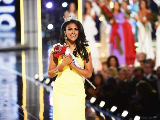 An overwhelmed Miss America, Nina Davuluri, poses for the shutterbugs.