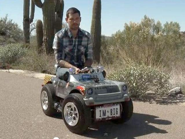 Custom-car-maker-Austin-Coulson-in-the-world-s-smallest-roadworthy-car-Photo-from-YouTube-video