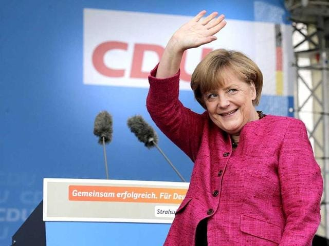 German-Chancellor-Angela-Merkel-waves-during-an-election-campaign-event-of-the-Christian-Democratic-Union-party-in-Stralsund-AFP-photo