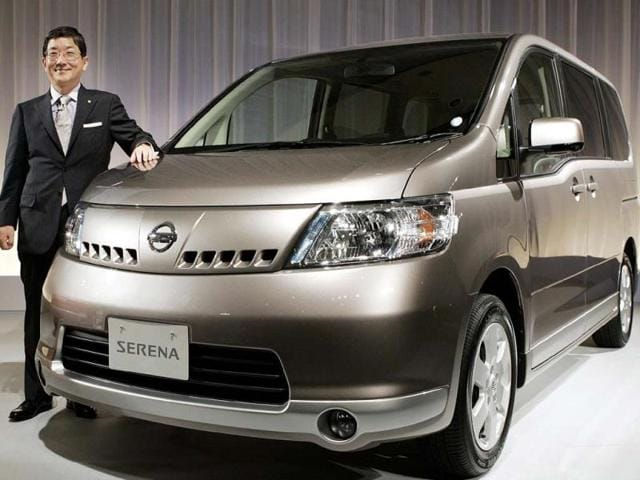 Files-In-this-file-picture-taken-on-May-31-2005-Nissan-Motors-chief-operating-officer-COO-Toshiyuki-Shiga-stands-beside-the-company-s-all-new-Serena-minivan-during-its-press-preview-at-a-Tokyo-hotel-Japanese-auto-giant-Nissan-said-on-September-26-2013-it-would-recall-about-910-000-cars-worldwide-over-an-accelerator-glitch-that-can-stall-vehicle-engines-The-global-recall-covers-five-models-including-the-Serena-minivan-and-X-Trail-SUV-produced-between-October-2004-and-June-this-year-it-said-Photo-AFP-Toshifumi-Kitamura