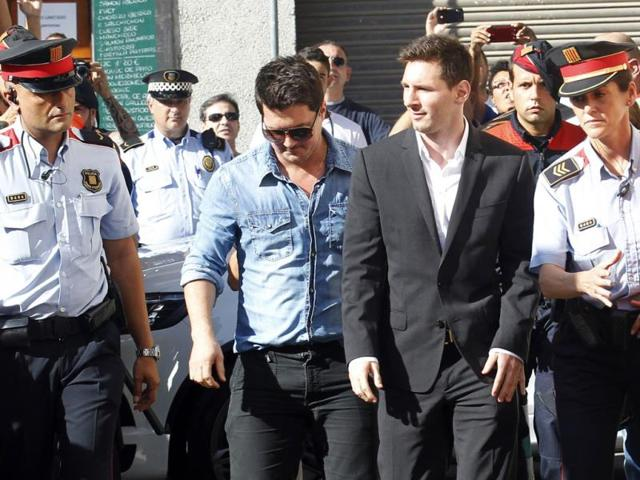 Barcelona-forward-Lionel-Messi-2nd-right-arrives-in-court-to-answer-charges-of-tax-evasion-in-Gava-Reuters-photo