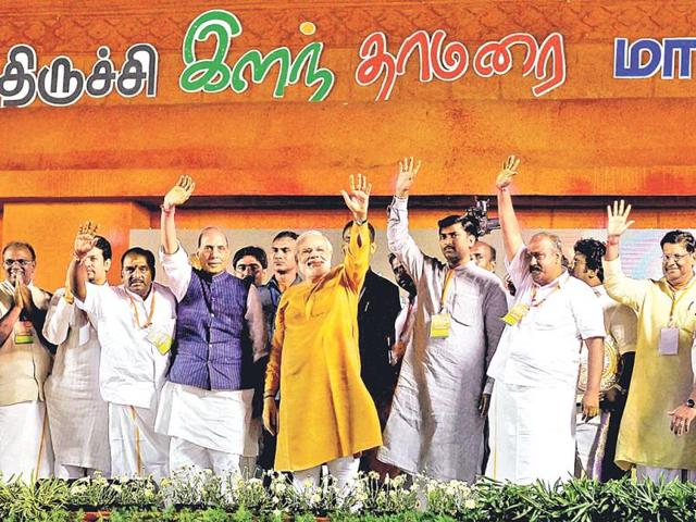 BJP-s--PM-candidate-Narendra-Modi-waves-with-senior-leaders-at-the-party-s-rally-in-Tiruchirapalli-on-September-26-The-focus-on-southern-states-by-the-BJP-could-help-them-make-up-for-deficits-in-the-north-PTI-Photo