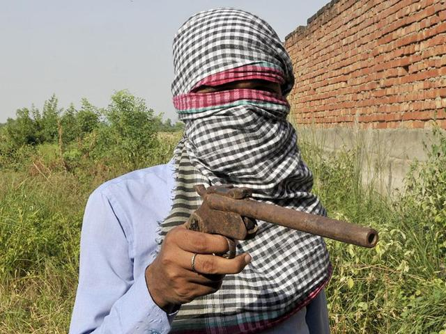 Children-of-a-village-near-Etah-show-their-family-gun-In-Uttar-Pradesh-private-individuals-possess-more-weapons-than-the-police-Vipin-Kumar-HT-photo