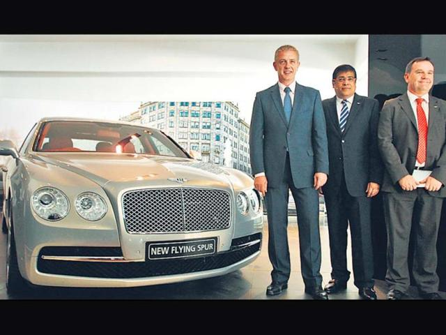Regional-manager-India-Chris-Buxton-R-and-MD-Exclusive-Motors-Satya-Bagla-L-pose-with-Bentley-s-Flying-Spur-in-New-Delhi-on-Monday-Photo-Jasjeet-Plaha-HT