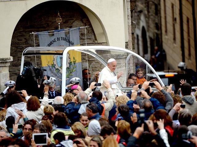 Pope-Francis-is-surrounded-by-cardinals-as-he-arrives-for-a-pastoral-visit-at-St-Francis-of-Assisi-AFP-Photo