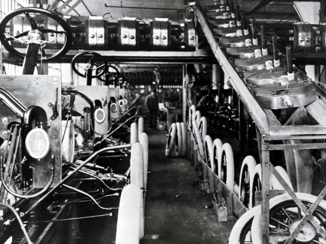 A century ago,Ford's assembly line changed society,Ford Model T past 140 workers