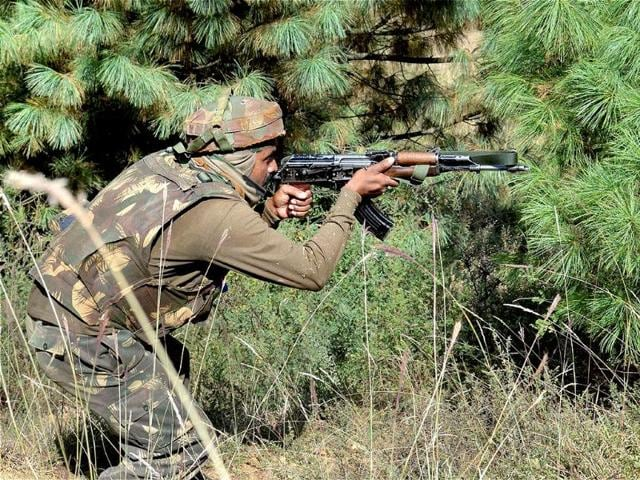 An Army soldier taking position during an encounter with militants in Keran sector of Jammu and Kashmir. (PTI Photo)