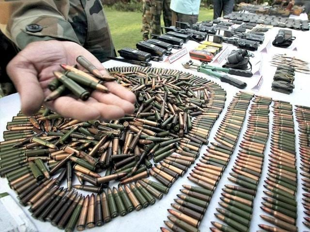 Army displaying arms and ammunition recovered from militants who were killed in recent encounters while trying to infiltrate in the Keran Sector of Jammu and Kashmir. (PTI Photo)