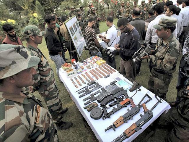 Army displaying arms and ammunition recovered from militants who were killed in recent encounters in the Keran Sector of Jammu and Kashmir in Srinagar. (PTI Photo)