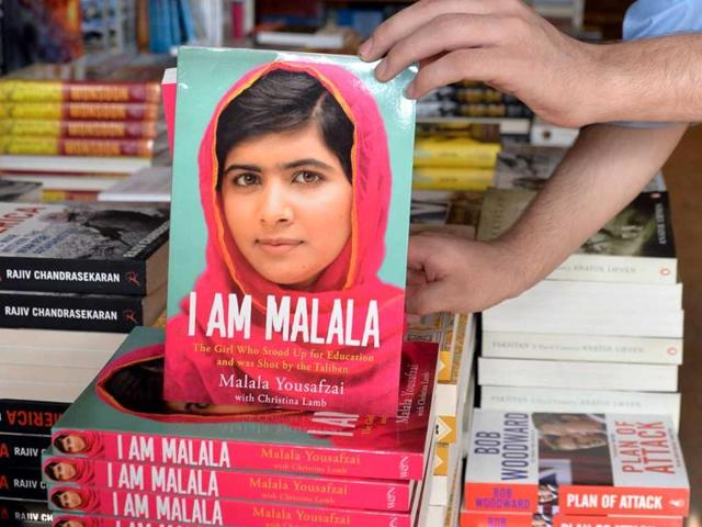 A-bookstore-employee-displays-copies-of-the-memoirs-of-Pakistani-child-activist-Malala-Yousafzai-in-Islamabad-AFP-photo