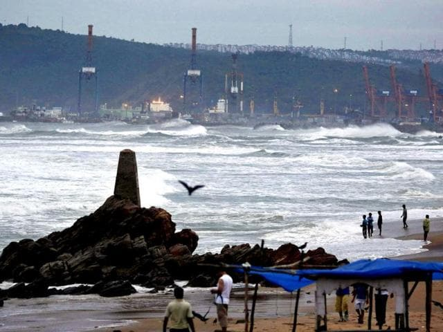 People-watch-as-waves-from-the-Bay-of-Bengal-approach-the-shore-in-Visakhapatnam-district-in-Andhra-Pradesh-Reuters