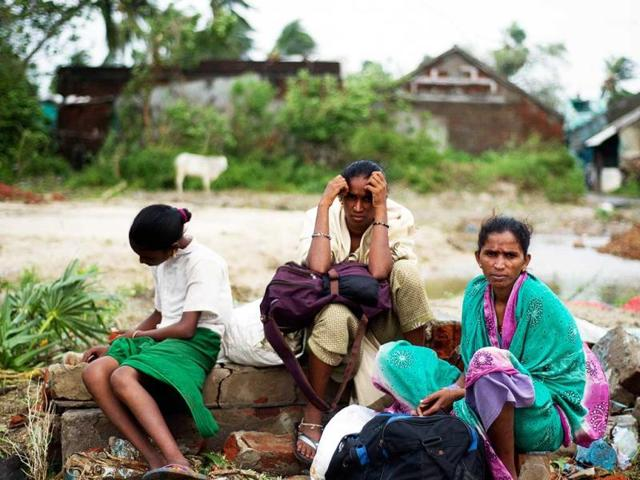 A displaced family waits in Sonupur village, 15 kms from Gopalpur. (AFP Photo)