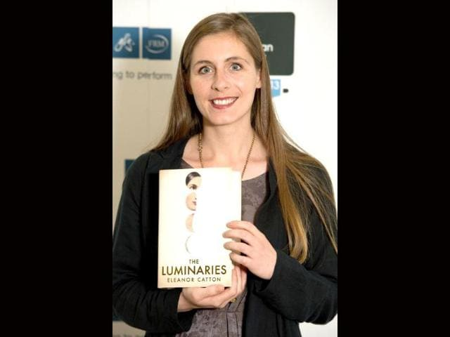 New-Zealand-author-Eleanor-Catton-poses-with-her-book-The-Luminaries-during-a-photo-call-for-shortlisted-Man-Booker-Prize-2013-authors-in-London-AFP-photo