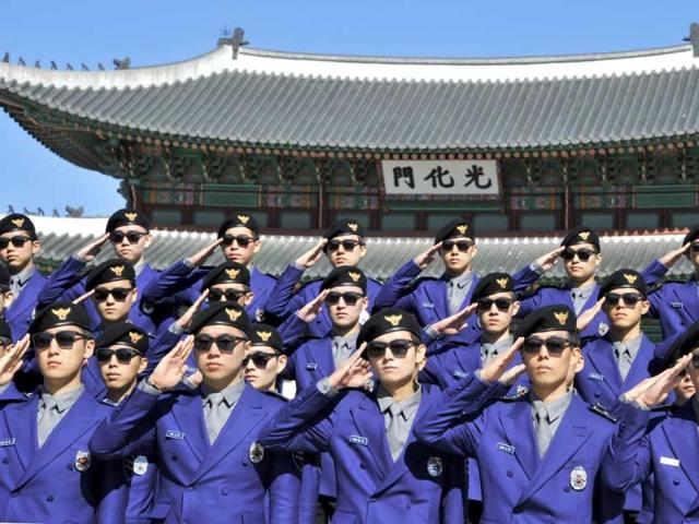 South-Korean-tourist-police-officers-salute-during-their-inauguration-ceremony-at-Gwanghwamun-square-in-Seoul-AFP-Photo