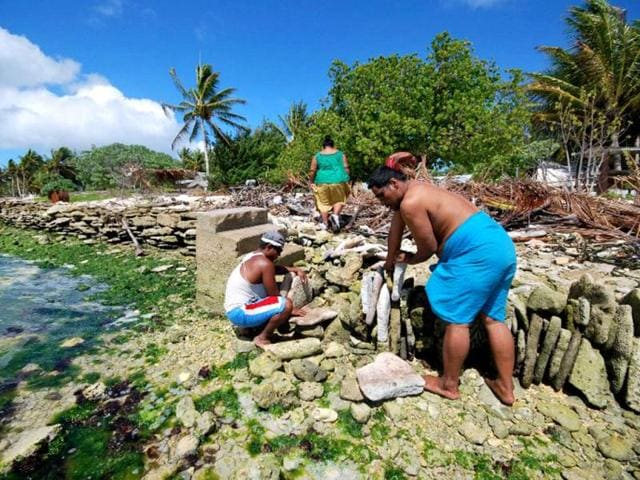 Residents-of-the-Republic-of-Kiribati-building-a-seawall-with-blocks-of-reef-to-protect-themselves-against-rising-sea-levels-due-to-global-warming-AFP-photo