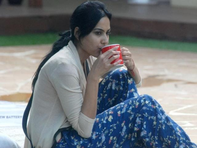Kamya sips her coffee alone. Plotting? We hope not.