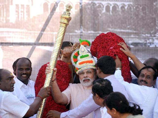 Gujarat-chief-minister-and-Bharatiya-Janata-Party-leader-Narendra-Modi-receives-scepter-and-a-floral-garland-during-his-visit-to-Chennai-on-Friday--PTI-Photo