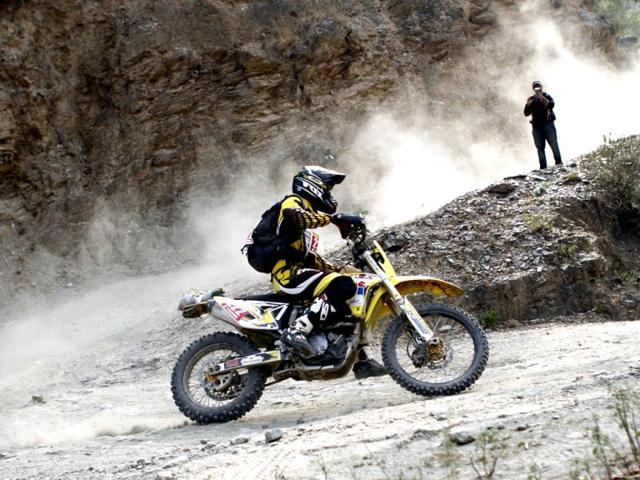 A biker crosses Behna, Himachal Pradesh during the 15th Raid De Himalaya rally which started from Shimla and ended in Leh. (HT Photo/Jasjeet Plaha)
