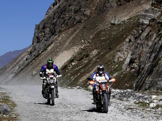 Bikers crosses Behna, Himachal Pradesh during the 15th Raid De Himalaya rally which started from Shimla and ended in Leh. (HT Photo/Jasjeet Plaha)