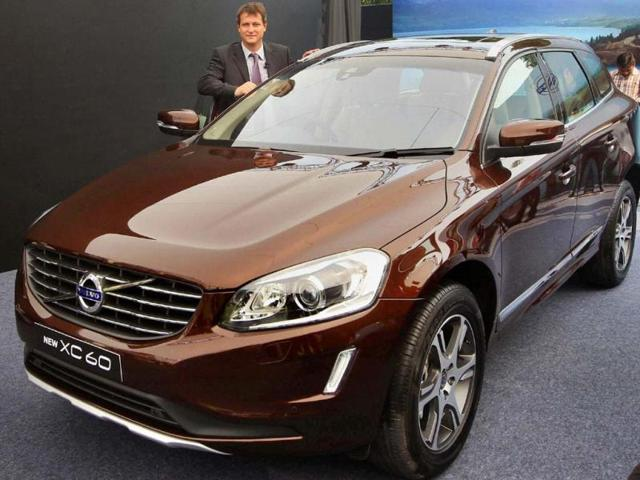 New-Delhi-Managing-Director-of-Volvo-Auto-India-Tomas-Ernberg-pose-with-the-newly-launched-Volvo-XC60-in-New-Delhi-on-Wednesday-Photo-PTI-Kamal-Singh