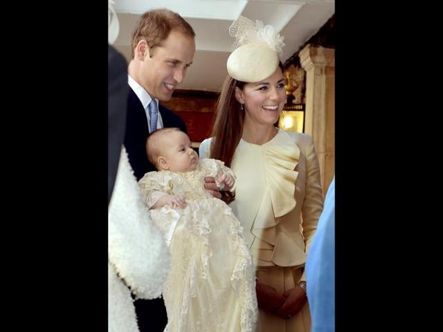 This-image-taken-by-Michael-Middleton-the-Duchess-s-father-and-supplied-by-Kensington-Palace-shows-the-Duke-and-Duchess-of-Cambridge-with-their-son-Prince-George-in-the-garden-of-the-Middleton-family-home-in-Bucklebury-England-with--their-pet-dog-AP-Photo