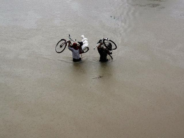 Roads-are-flooded-as-heavy-rains-continue-to-lash-Srikakulam-and-Nalgonda-districts-in-Andhra-Pradesh-PTI-photo