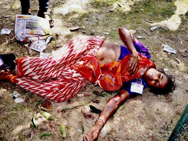 An injured woman laying on the ground after six serial bomb blasts took place at the venue of Narendra Modi