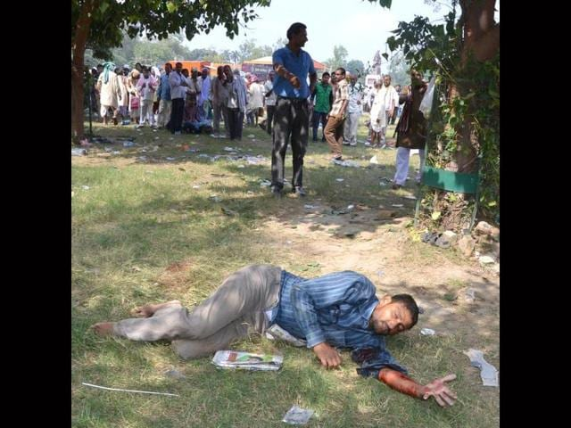 An injured man laying on the ground after a series of bomb blasts took place at the venue of Narendra Modi