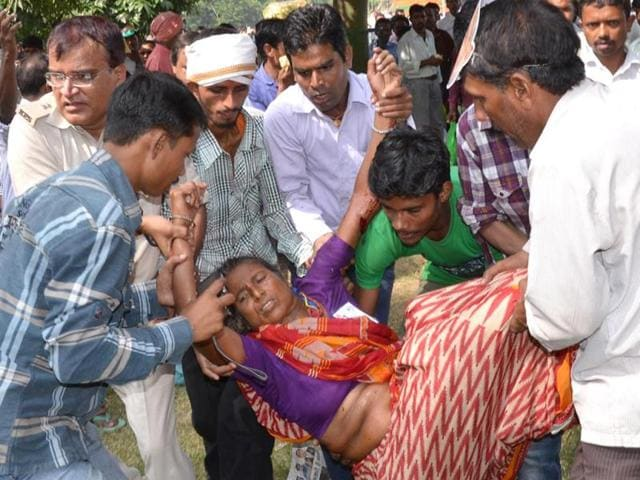 An injured woman is carried away from the venue of Narendra Modi