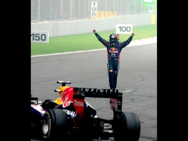 Sebastian-Vettel-of-Red-Bull-Racing-salutes-the-crowds-while-standing-atop-his-car-after-the-controversial-doughnut-celebration-at-the-Indian-Grand-Prix-at-the-Buddh-International-circuit-in-Greater-Noida-Vipin-Kumar-HT-Photo