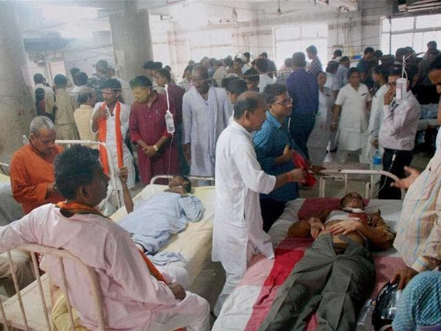 Injured people being admitted to a hospital after the blasts during BJP