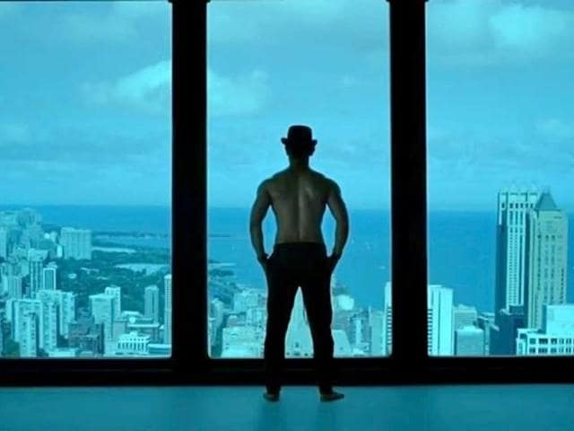 Aamir Khan bares his back.
