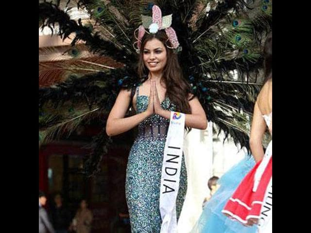 Srishti-Rana-Miss-Asia-Pacific-2013-flaunts-her-Shane-and-Peacock-gown-which-won-her-the-best-costume