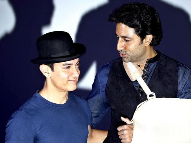 Aamir Khan and Abhishek Bachchan in a conversation at the trailer launch of Dhoom: 3 in Mumbai recently.(AP Photo)
