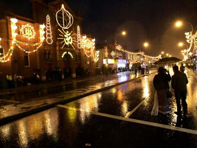 File-Photo-People-mill-arround-Leicester-city-centre-looking-at-the-festive-lights-in-Diwali-2001-AFP-Photo