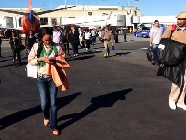 Airline-passengers-are-evacuated-to-the-tarmac-in-this-picture-after-the-firing-at-Los-Angeles-International-Airport-Reuters-Photo