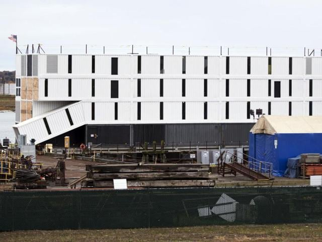 A-four-story-structure-rests-on-top-of-a-barge-in-Portland-Harbor-in-Portland-Maine-AP-Photo