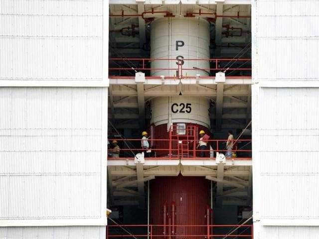 Technicians inspect the PSLV-C25 at the Satish Dhawan Space Center in Sriharikota. (AP photo)