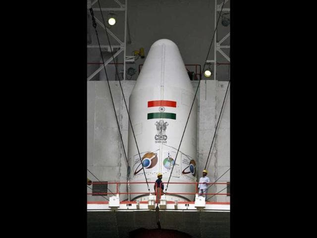Technicians are seen near the Polar Satellite Launch Vehicle (PSLV-C25) at the Satish Dhawan Space Center in Sriharikota. (AP photo)