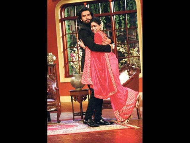 Love all: Sumona, who plays Kapil's wife on the show, hugs Ranveer Singh.