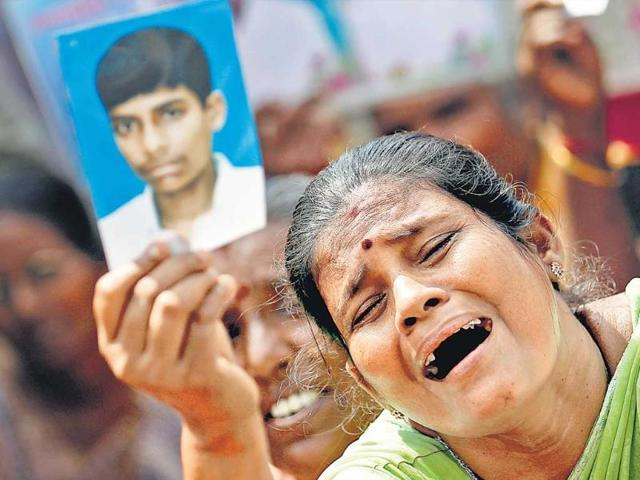 A-Sri-Lankan-Tamil-woman-cries-at-a-protest-in-Jaffna-as-she-holds-up-a-photograph-of-a-family-member-who-disappeared-during-the-civil-war-HT-Photo