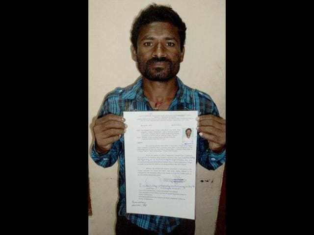 Nilachala-with-his-bonded-labourer-certificate