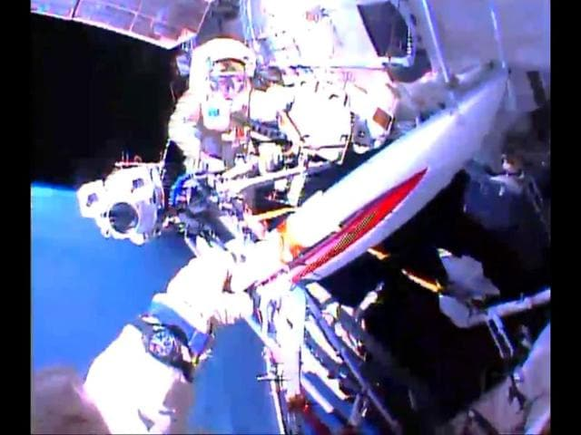 In-this-image-obtained-from-NASA-TV-Cosmonaut-Oleg-Kotov-holds-the-Olympic-Torch-in-front-of-Sergei-Ryazansky-rear-as-they-exit-the-International-Space-Station-with-the-Sochi-2014-Winter-Olympic-Games-torch-AFP-Photo-Nasa-TV