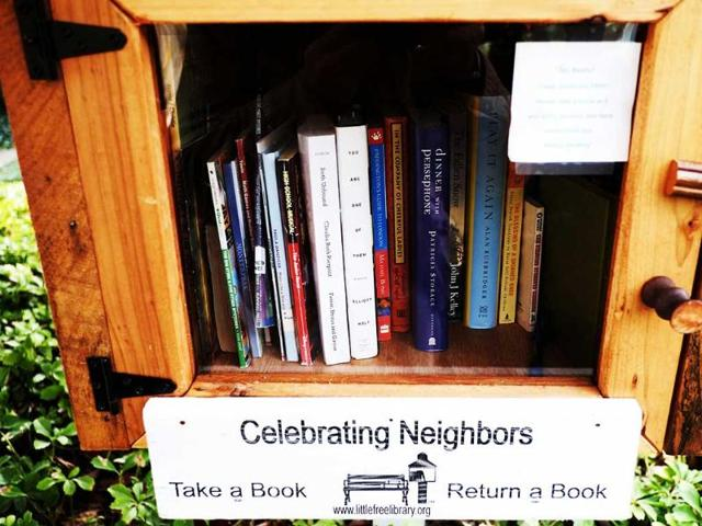 A-Little-Library-book-lending-kiosk-is-viewed-in-front-of-a-home-in-Washington-DC-The-small-libraries-have-flourished-in-Washington-DC-encouraging-people-to-read-AFP-Photo