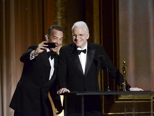 Actor-Tom-Hanks-takes-a-photo-with-actor-and-honoree-Steve-Martin-at-the-2013-Governors-Awards-in-Los-Angeles-AP-Photo