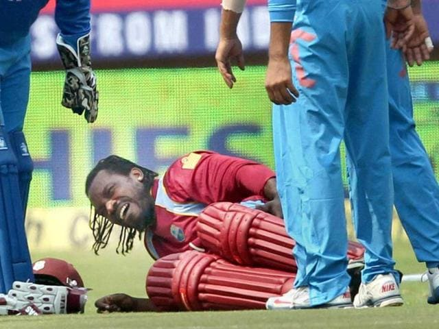 Chris-Gayle-writhes-in-pain-after-sustaining-an-injury-while-completing-a-run-during-the-1st-ODI-match-against-India-at-Jawaharlal-Nehru-Stadium-in-Kochi-PTI-photo