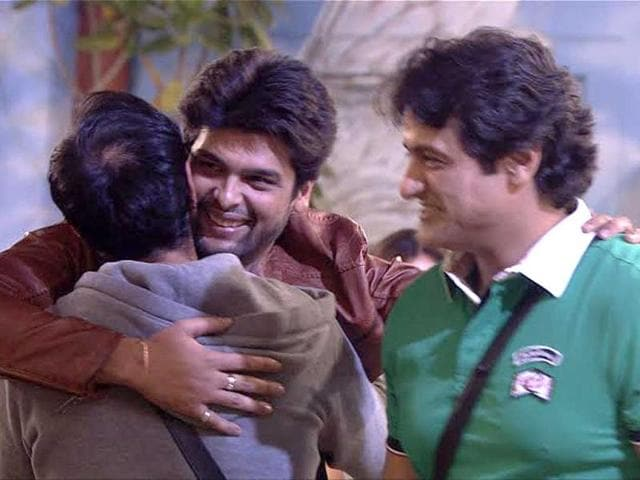 Kushal meets Andy warmly; an elated Armaan looks on.