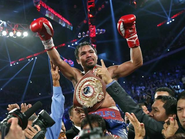 Manny-Pacquiao-from-the-Philippines-wears-the-champion-s-belt-after-defeating-Brandon-Rios-of-the-United-States-in-their-WBO-international-welterweight-title-fight-in-Macau-AP-Photo