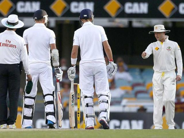 Australia-s-captain-Michael-Clarke-R-talks-to-England-s-James-Anderson-2nd-L-as-batsman-Joe-Root-2nd-R-and-umpire-Aleem-Dar-look-on-during-the-fourth-day-of-the-first-Ashes-cricket-Test-match-in-Brisbane-Reuters-Photo