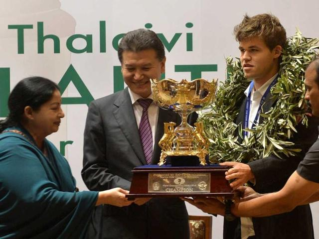 The-new-world-chess-champion-Norwegian-Magnus-Carlsen-R-receives-the-trophy-from-the-president-of-the-World-Chess-Federation-Fide-Kirsan-Ilyumzhinov-2L-and-chief-minister-of-Tamil-Nadu-J-Jayalalithaa-L-during--a-presentation-ceremony-in-Chennai-AFP-Photo